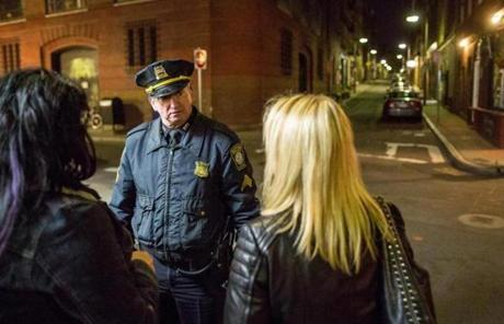 Sergeant James Earle asked a small group to quiet down while walking outside Bova's Bakery  in the North End in Boston at 2:30 a.m. The officer was there to prevent loitering and excessive noise outside the 24-hour bakery.